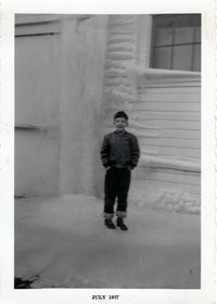 Bruce in front of frozen wall - 1957